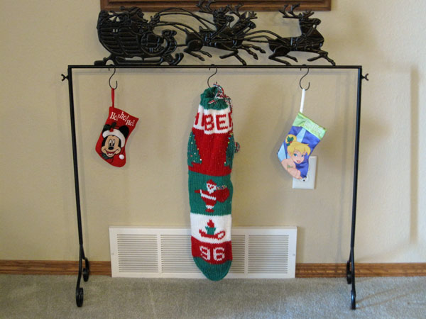 crafted of metal with an espresso finish this stocking holder features a silhouette design of santau0027s sleigh complete your christmas decorating or start a - Stocking Hangers For Mantle